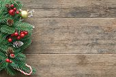 Old Wood Texture Decorate With Pine Leaf, Pine Cones, Holly Balls, Golden Ball And Candy Cane In Chr poster