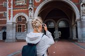 Woman Tourist Visiting Museum In Amsterdam. Travel In Europe City Trip Concept poster