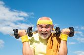 Portrait Of Healthy Happy Smile Senior. Happy Senior Man With Dumbbell Looking At Camera. Grandfathe poster