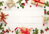 Christmas background with gift boxes, Christmas decorations and branches of holly and fir on white w poster