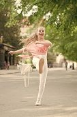 Casual Look. Happy Small Girl Marching Along Street In Casual And Comfy Clothes. Little Cute Child S poster