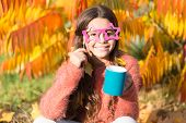 Aint It Funny. I Love Smell Of Autumn Leaves In Morning. Happy Little Child Hold Coffee Cup On Autum poster