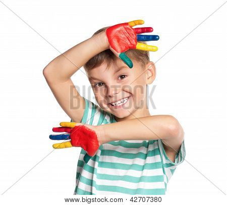 Little boy with paints on hands