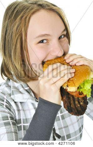Teenage Girl Holding Big Hamburger