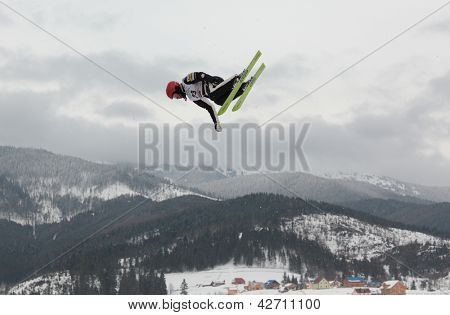 BUKOVEL, UKRAINE - FEBRUARY 23: Alex Bowen, USA performs aerial skiing during Freestyle Ski World Cup in Bukovel, Ukraine on February 23, 2013.