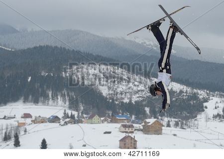BUKOVEL, UKRAINE - FEBRUARY 23: Emily Cook, USA performs aerial skiing during Freestyle Ski World Cup in Bukovel, Ukraine on February 23, 2013.