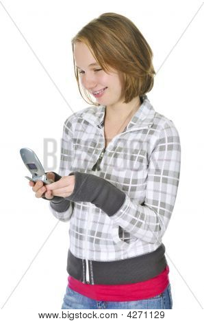Teenage Girl Text Messaging On A Cell Phone