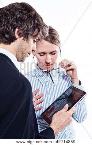 Business couple with tablet computer