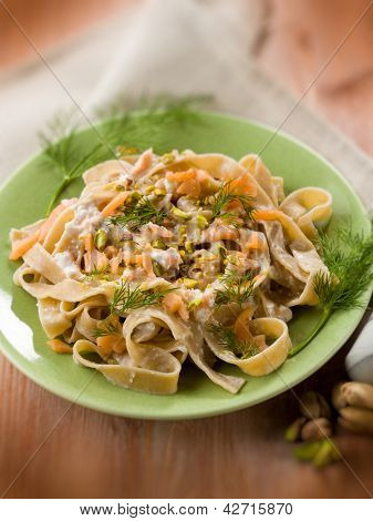 pasta with salmon pistachio and cream sauce, selective focus