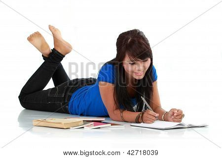 Young Smiling Asian Woman With Book And Pen Isolated