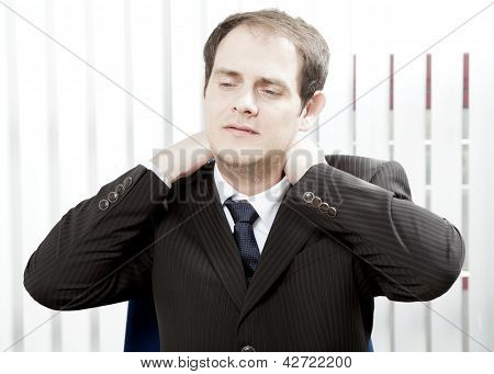 Businessman With A Stiff Neck