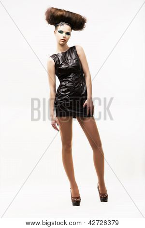 Individuality. Exquisite Modern Woman Standing In Black Trendy Dress. Fashion Style