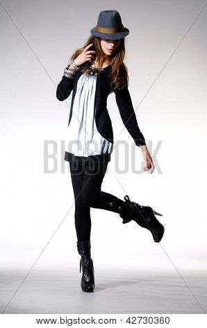Full length Beautiful slim woman in sunglasses posing