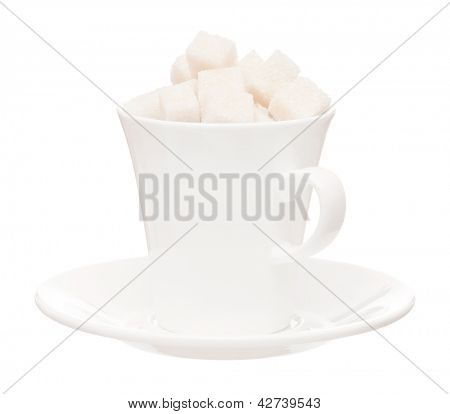 Small white cup with saucer and lump sugar isolated on white background