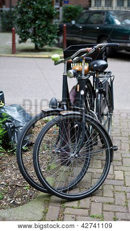 Two Parked Commuter Bikes