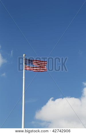 American flag damaged by superstorm flying high four months after Hurricane Sandy