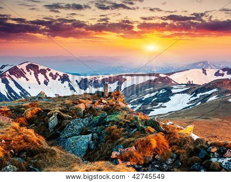 Majestic sunset in the mountains landscape. Dramatic sky. Carpathian, Ukraine.
