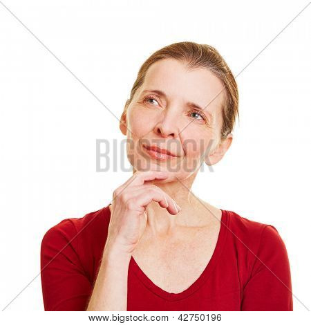 Elderly pensive woman looking up and thinking