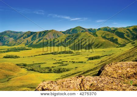 Mountains And Medow Landscape