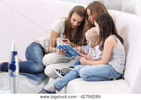 Mother Sitting With Children Reading Story