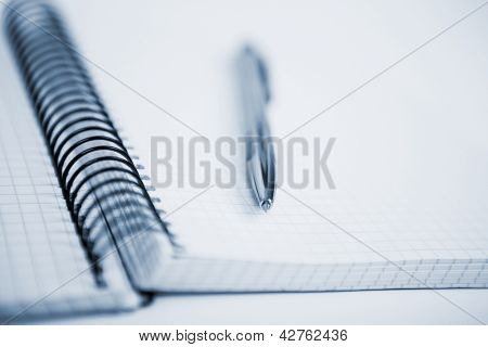 Notebook and pen in composition in black and white