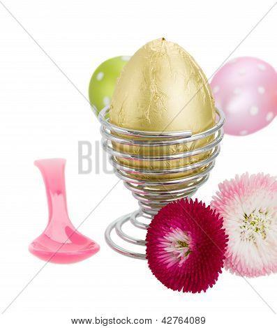 easter egg in egg holder with flowers
