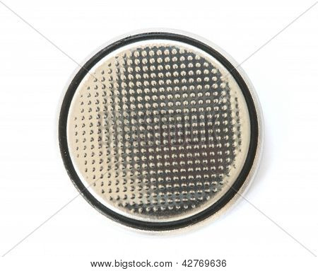 Silver button cell battery on white background