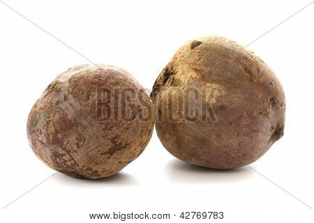 Two whole beetroots also called red beet on white background