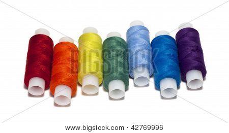 Rainbow Colored Spools Of Thread