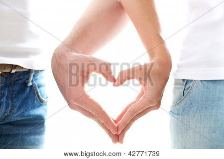 Conceptual image of female and male hands making up heart shape