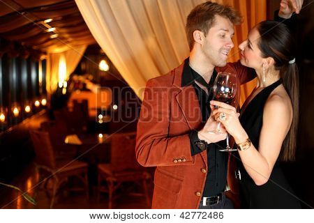 to a good girl flirting young man with a glass of wine