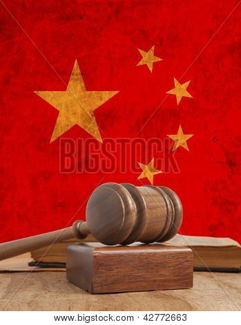 Wooden gavel and vintage China flag