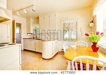 White Old Small Kitchen In American House Build In 1942.