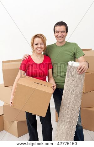 Happy couple moving into a new home together