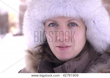 Girl in a cap with ear-flaps