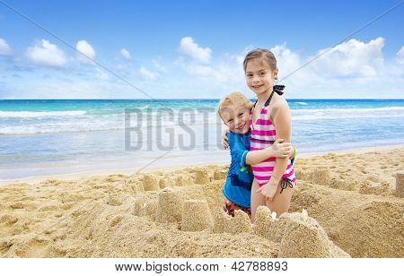 Children building Sandcastles on the Beach