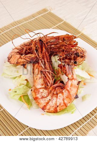 Seared Jumbo prawns with lettuce on restaurant table