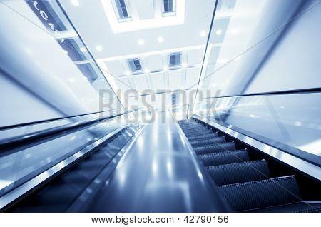 Escalator in modern office building,motion blur