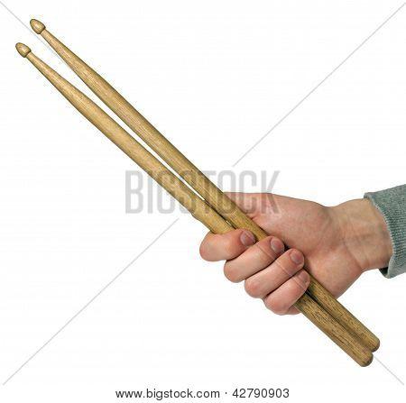 Hand Holding Drumsticks