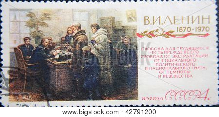 RUSSIA - CIRCA 1970: stamp printed by USSR shows socialist lider Lenin talking with few people