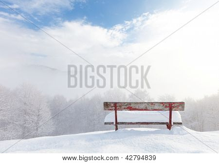 red bench empty desolate winter landscape