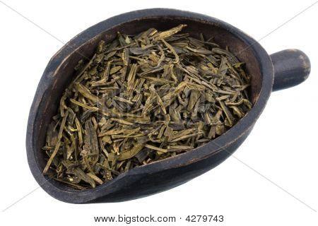 Cuchara de té suelto de verde hoja completa