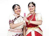 foto of bharatanatyam  - female dancers of indian origin one odissi and the other Bharathanatyam dancer - JPG