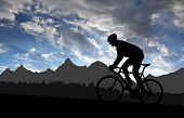 foto of boys night out  - silhouette of the cyclist riding a road bike at sunset - JPG
