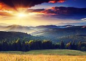 image of morning sunrise  - Majestic sunset in the mountains landscape - JPG