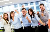 stock photo of coworkers  - Successful business group with arms up at the office - JPG