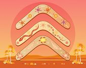 stock photo of boomerang  - an illustration of an abstract australian landscape with three different designs of boomerang with a hot outback sun - JPG