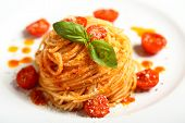 stock photo of pasta  - italian pasta spaghetti with tomato sauce and basil - JPG