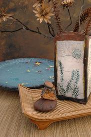 stock photo of raku  - zen spa still life with raku vase - JPG