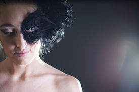 stock photo of azazel  - portrait of sexy woman with black feather half mask for Venice desire concept - JPG